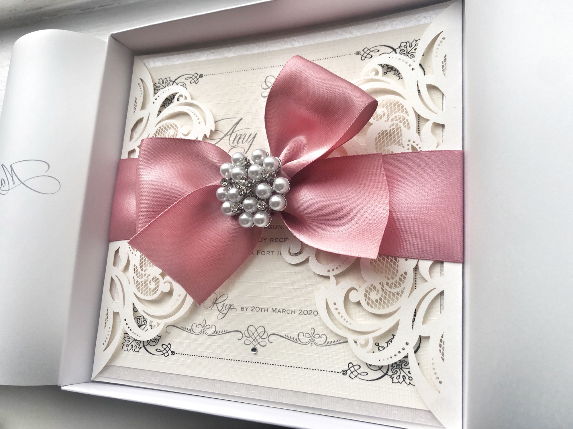 Luxury boxed wedding invitations with large pearl bow