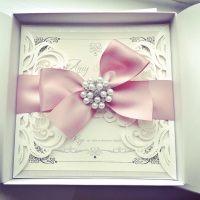 Laser Cut Invitation Sample with Large Bow and Pearl Brooch