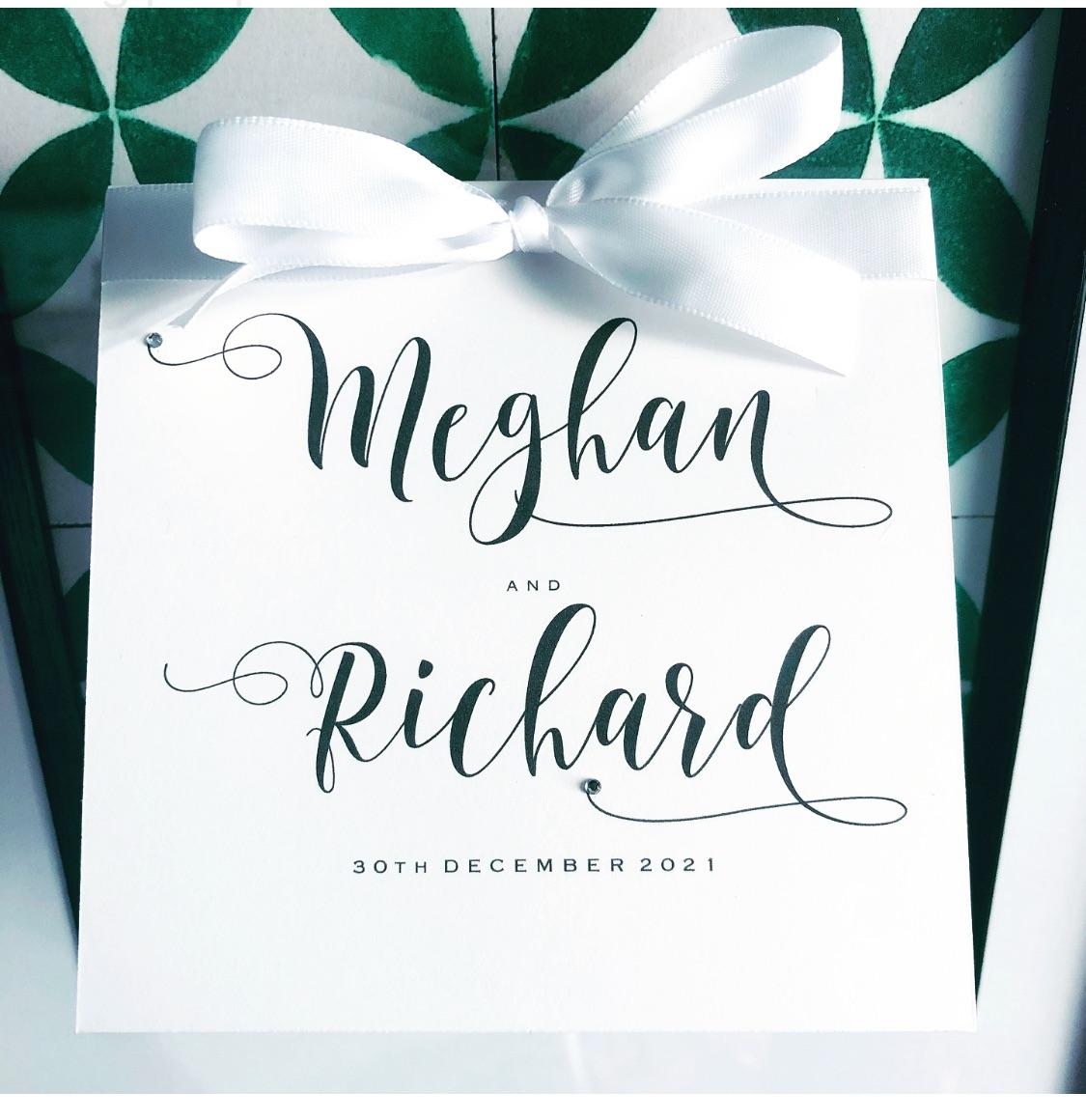 White wedding invitations with beautiful swirly fonts