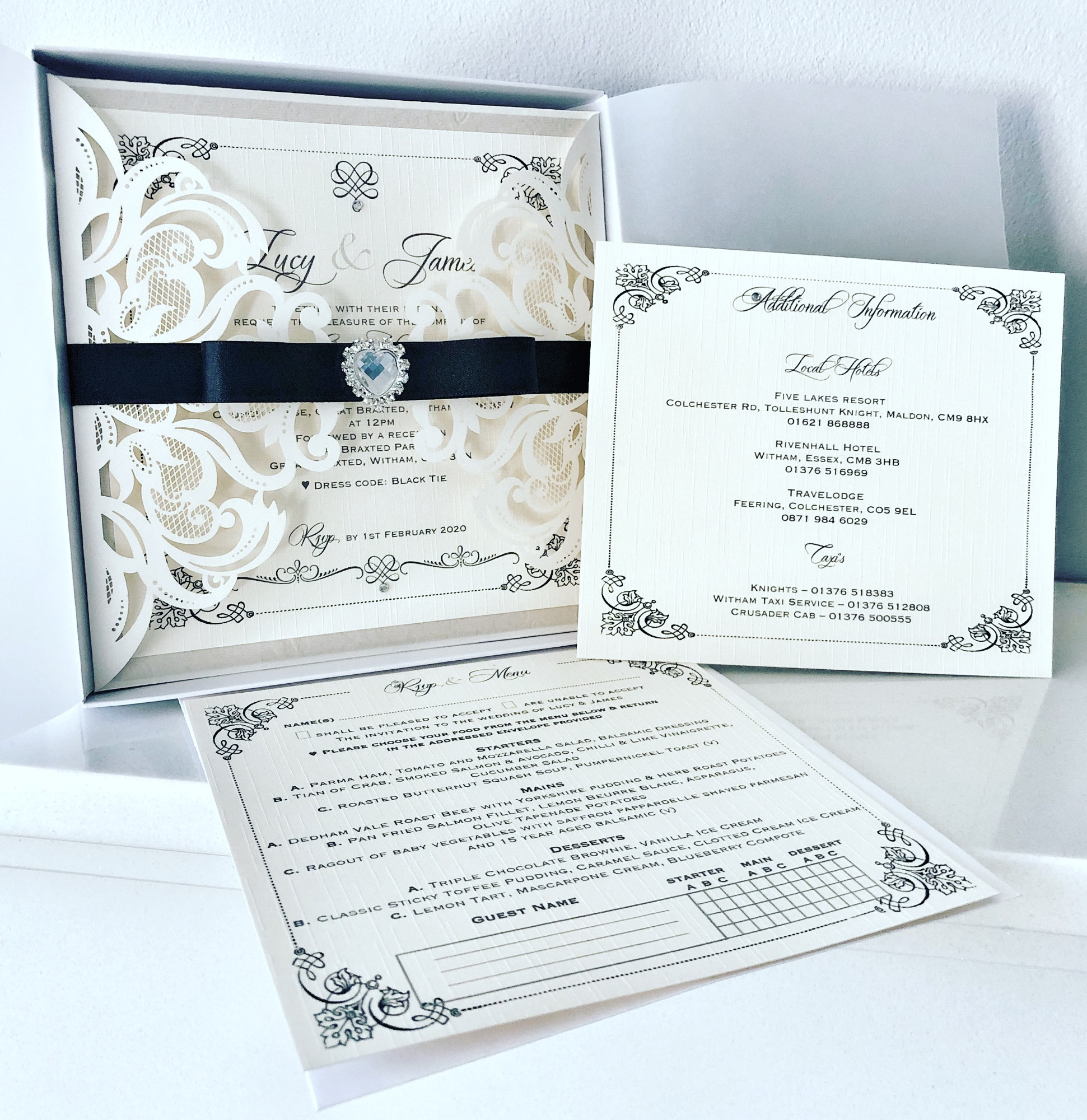 Laser cut invitation with black tie bow