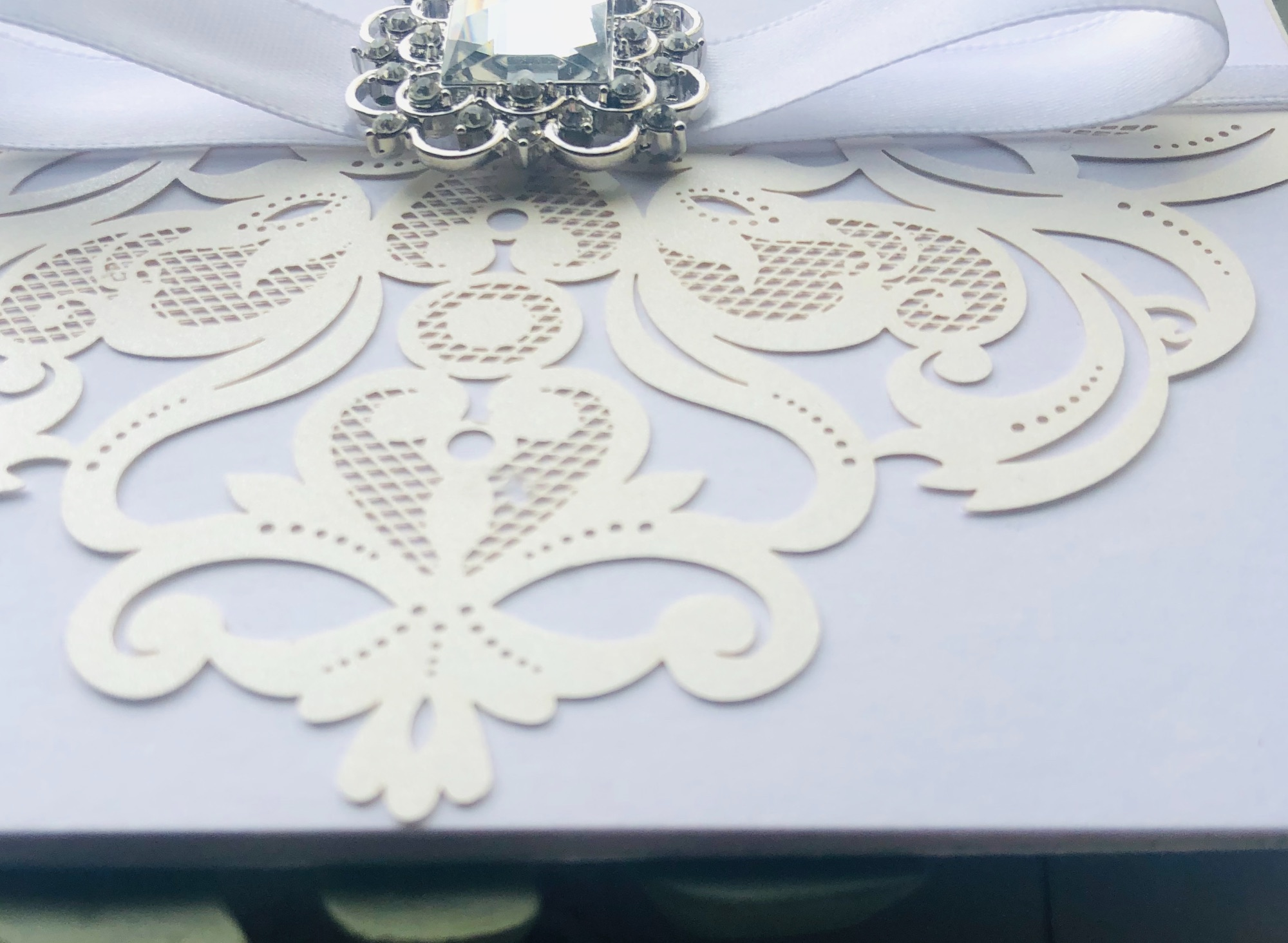 Invitation with crystal brooch