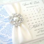 save the date cards with ivory ribbon and powder blue damask detail