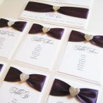 Wedding table plan with purple ribbon and diamante heart