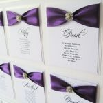 Wedding table plan with purple ribbon and diamante flower