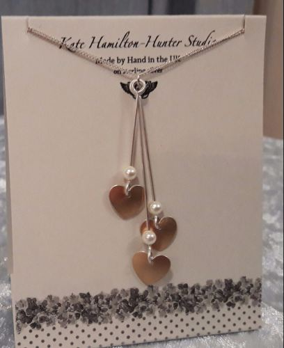 3 tiered rose gold coloured necklace