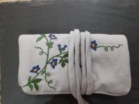 Fairtrade floral embroidered jewellery roll