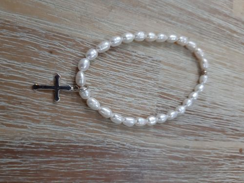 Pearl extending bracelet with silver cross charm
