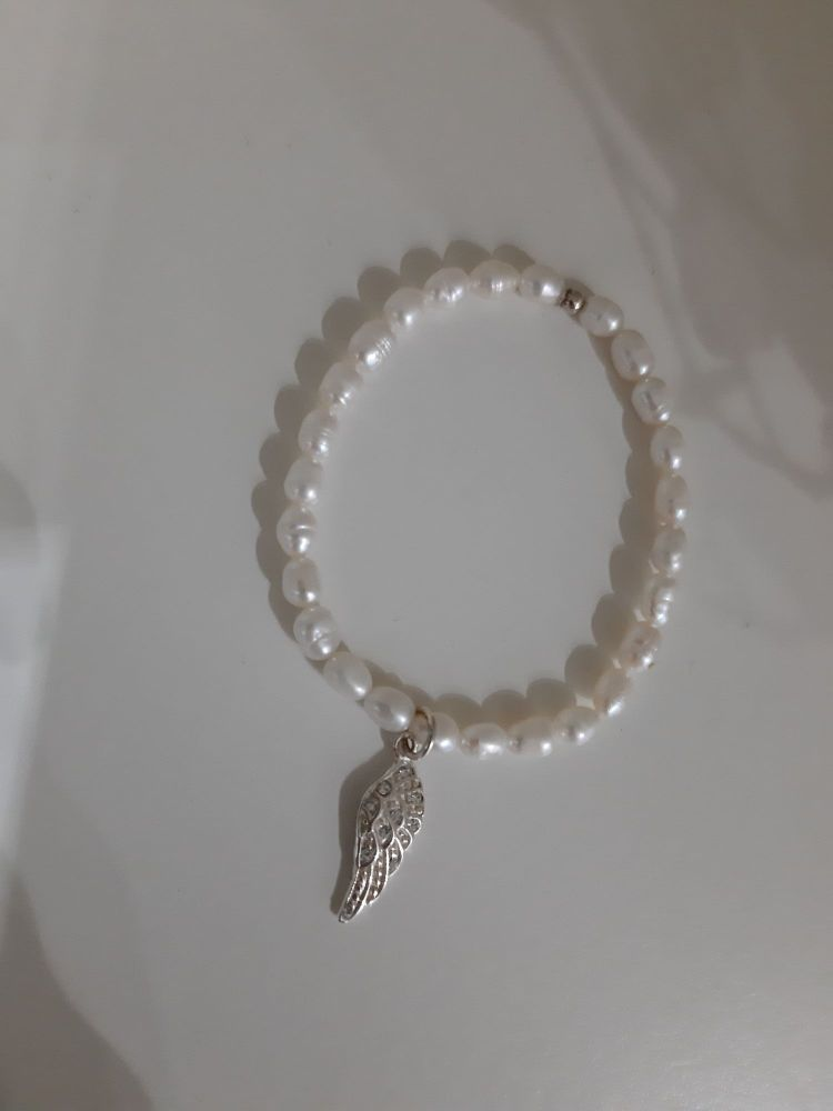 Child's pearl and silver angel wing stretchy bracelet