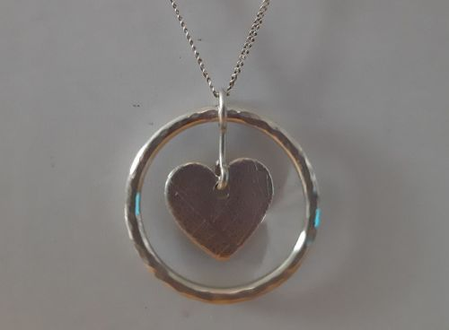 Silver circle and heart necklace