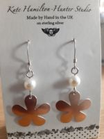 Rose gold coloured flower and pearl earrings
