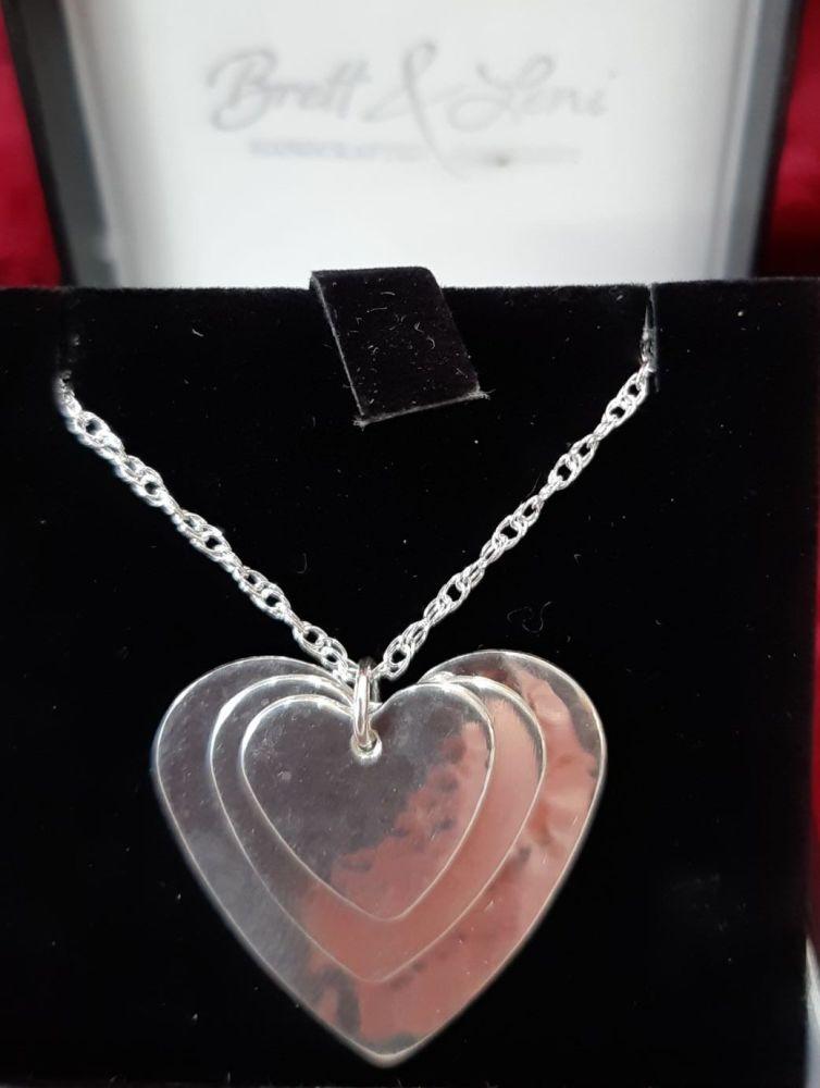 Handmade silver triple heart pendant