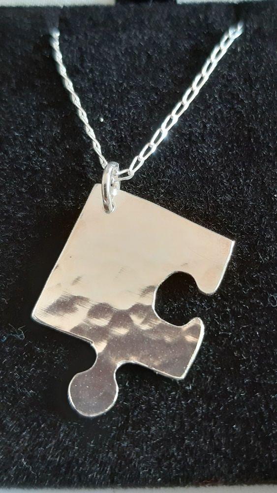 Handmade silver puzzle piece pendant