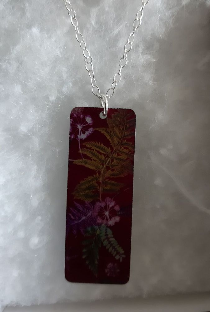 Aluminium pendant with botanical design