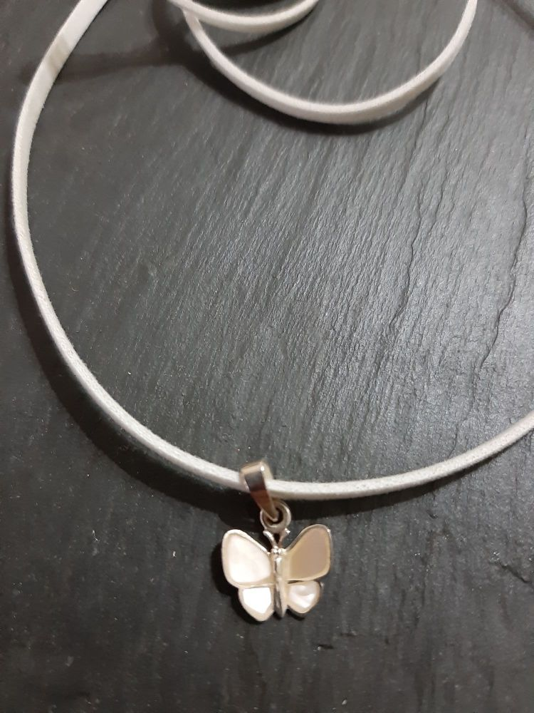 Butterfly silver and mother of pearl  pendant on faux leather thong
