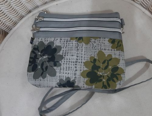 Small grey floral oilskin crossover bag