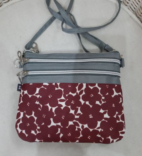 Small red flower oilskin crossover bag