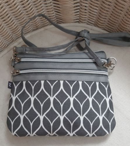 Small oilskin crossover bag