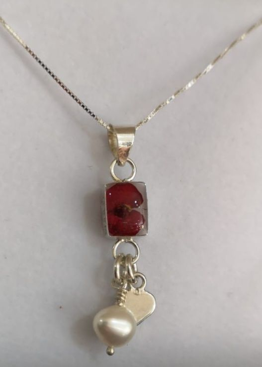 Poppy necklace with Sterling silver heart charm pendant with a single mini