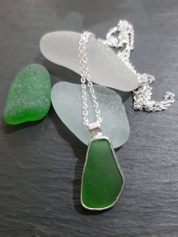 Green Seaglass pendant (chain purchased seperately)  with silver bezel surr