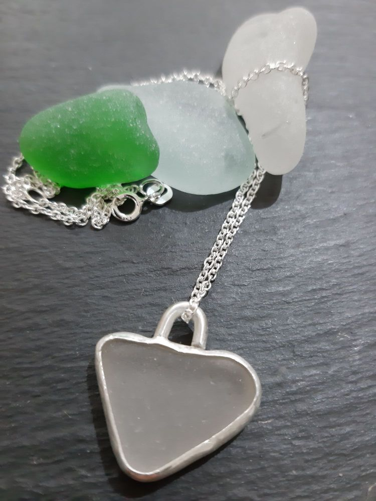 White Seaglass heart pendant (chain purchased seperately)  with silver beze