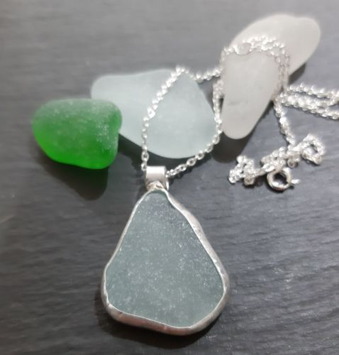 Aqua Seaglass  pendant (chain purchased seperately)  with silver bezel surr
