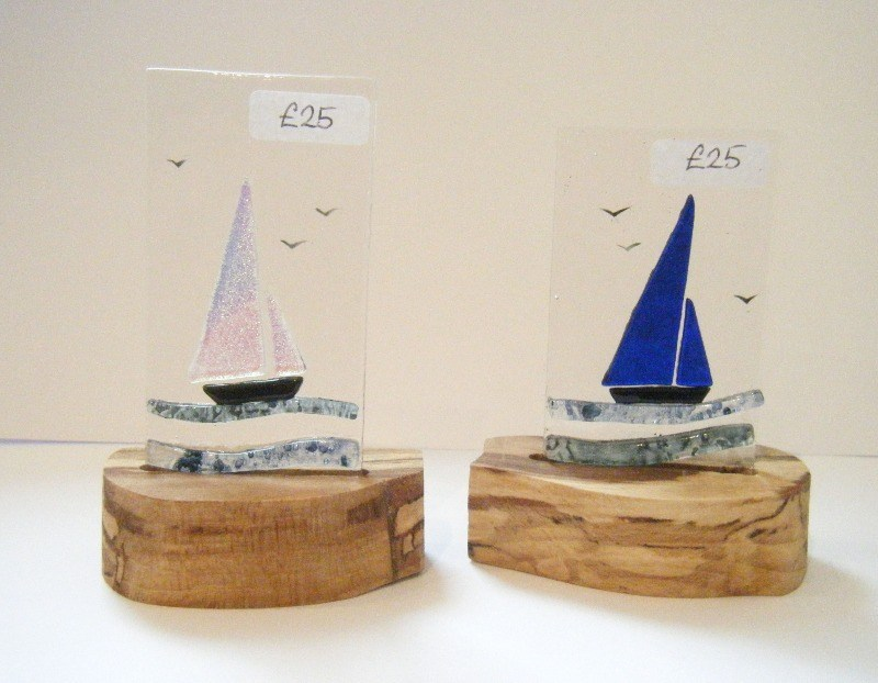 glass boats on wooden stands
