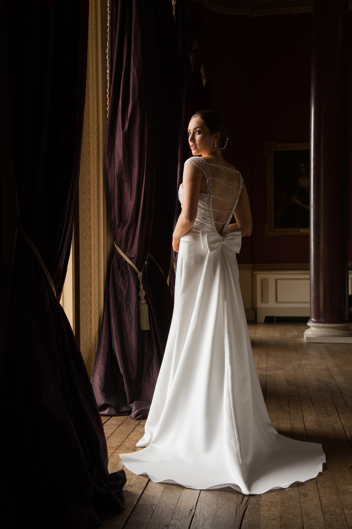 Gorgeous Satin gown with beaded straps, stunning beaded chain details across the deep V back & fully detachable train.