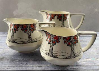 "Crown Ducal ""Orange Tree"" set of three graduating custard jugs"