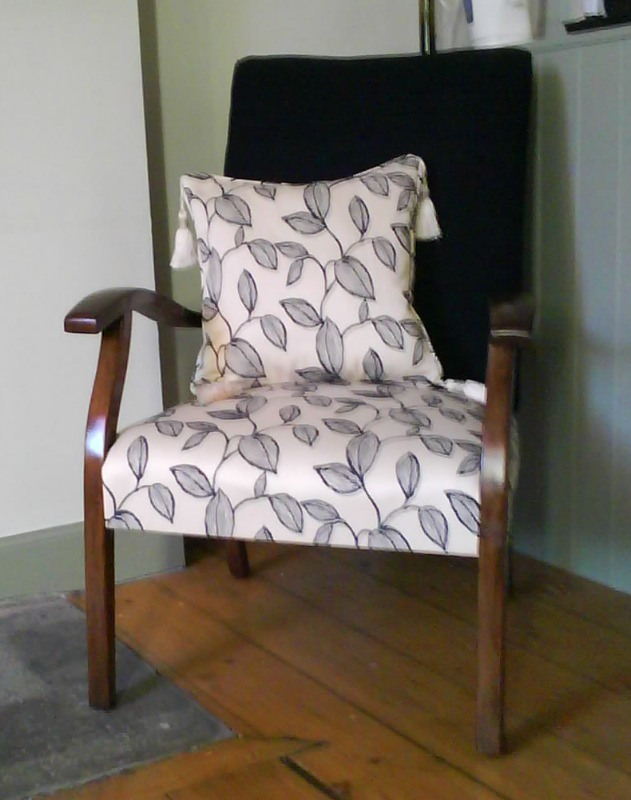 antique chair with patterned seat and and scater, with bold black back
