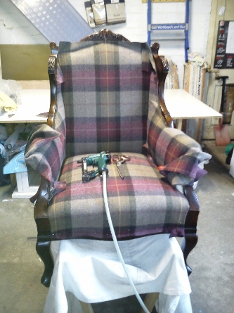 antique chair getting upholstered