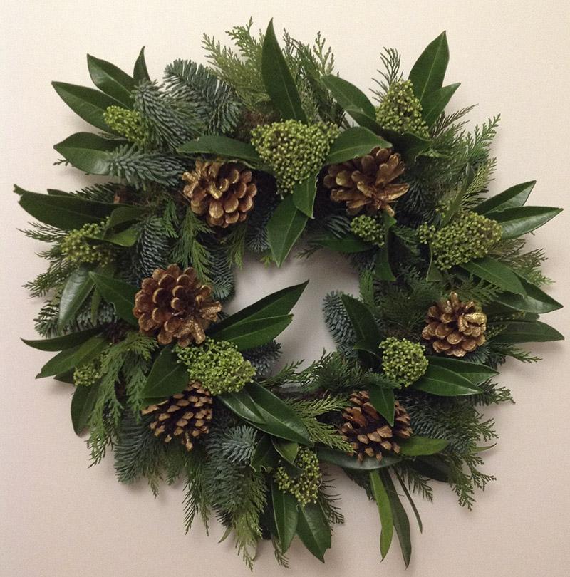 Skimmia and acorn christmas wreath