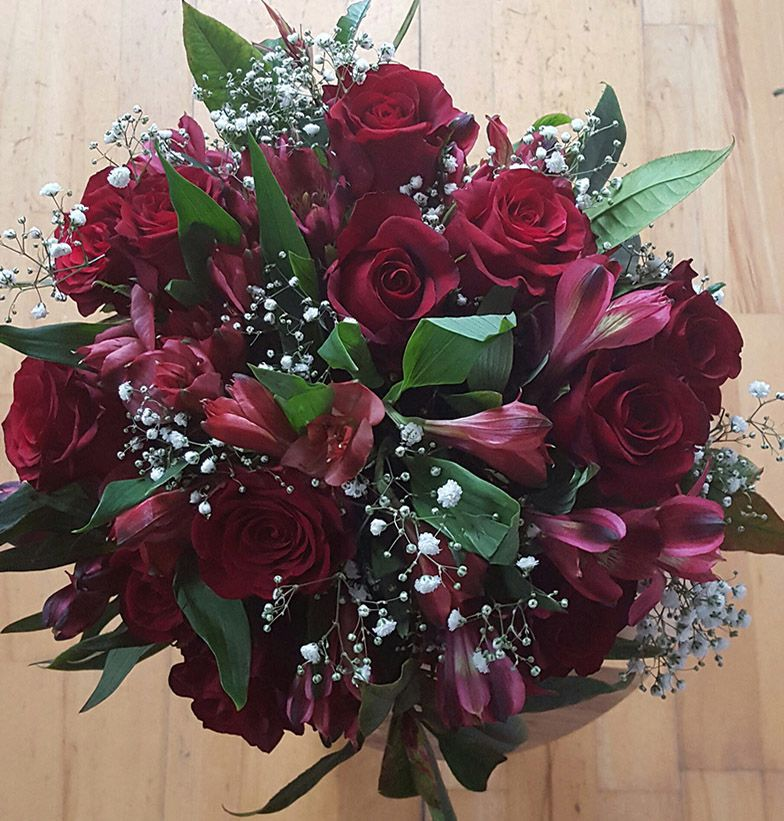 A dozen red roses and alstroemeria