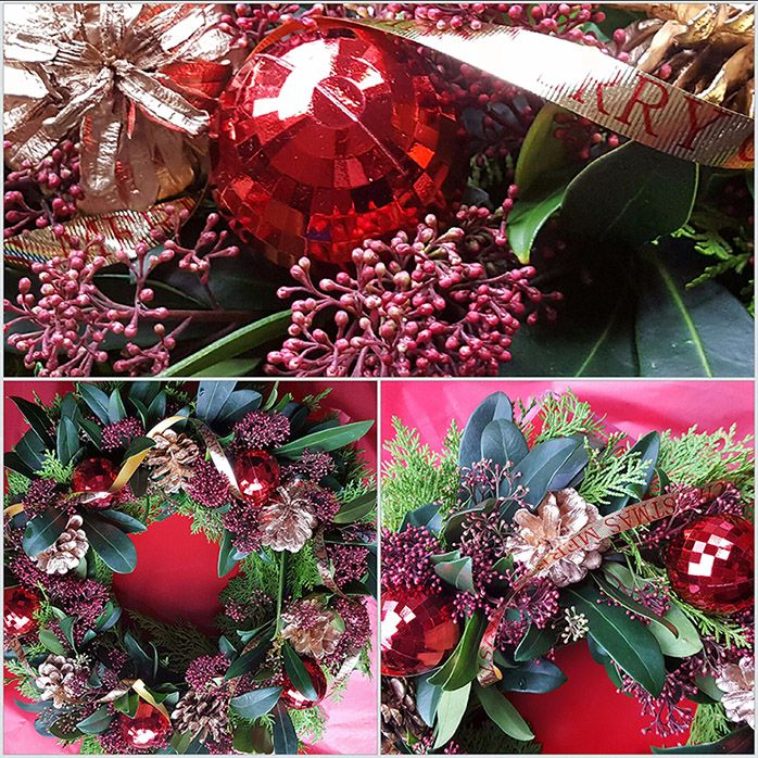 Skimmia christmas wreath with acorns and christmas decorations
