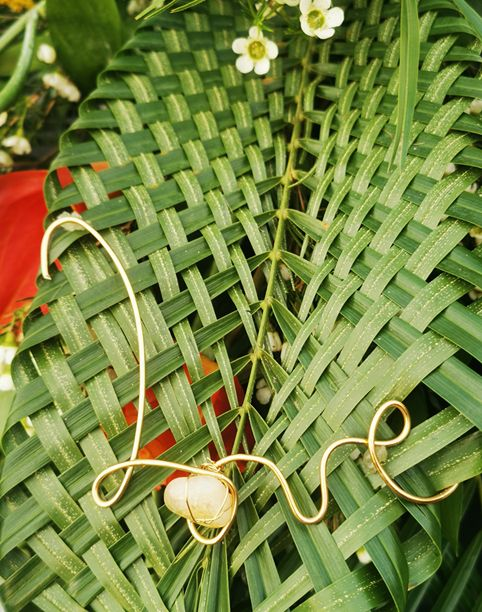 Wire writing love,  citrine crystal on palm woven basket leaf