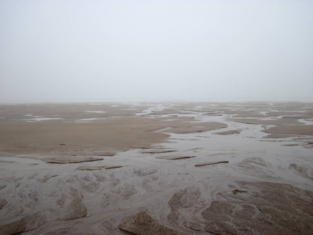 misty morning warkowrth beach looking out to sea