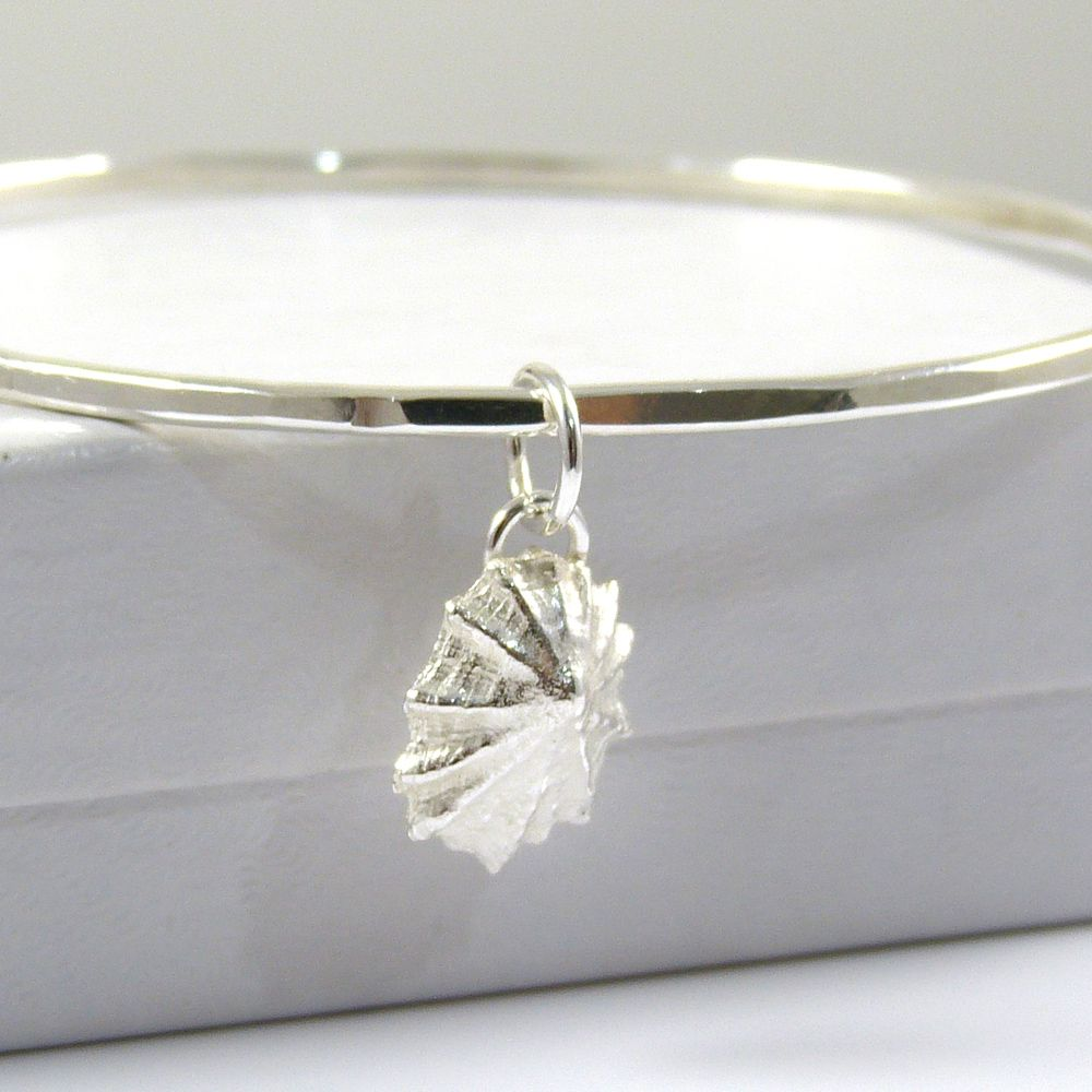 Sterling Silver Hammered Bangle with Tiny Limpet Shell Charm