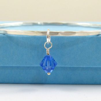 Sterling Silver Hammered Stacking Bangle with a Swarovski Crystal Birthstone Charm