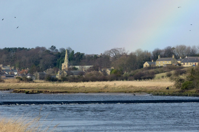 rainbow over church of st lawrence warkworth