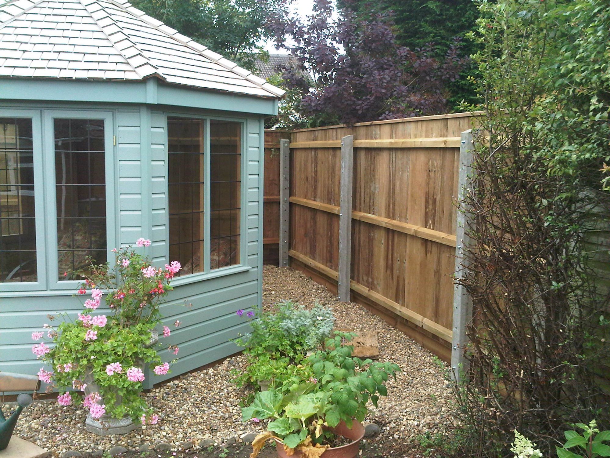 Concrete Posts & Feather Edge Fencing