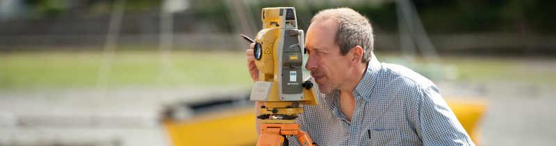John Preston surveying at Insworke Mill, Millbrook