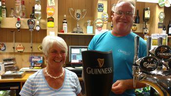 Edie and John at the bar