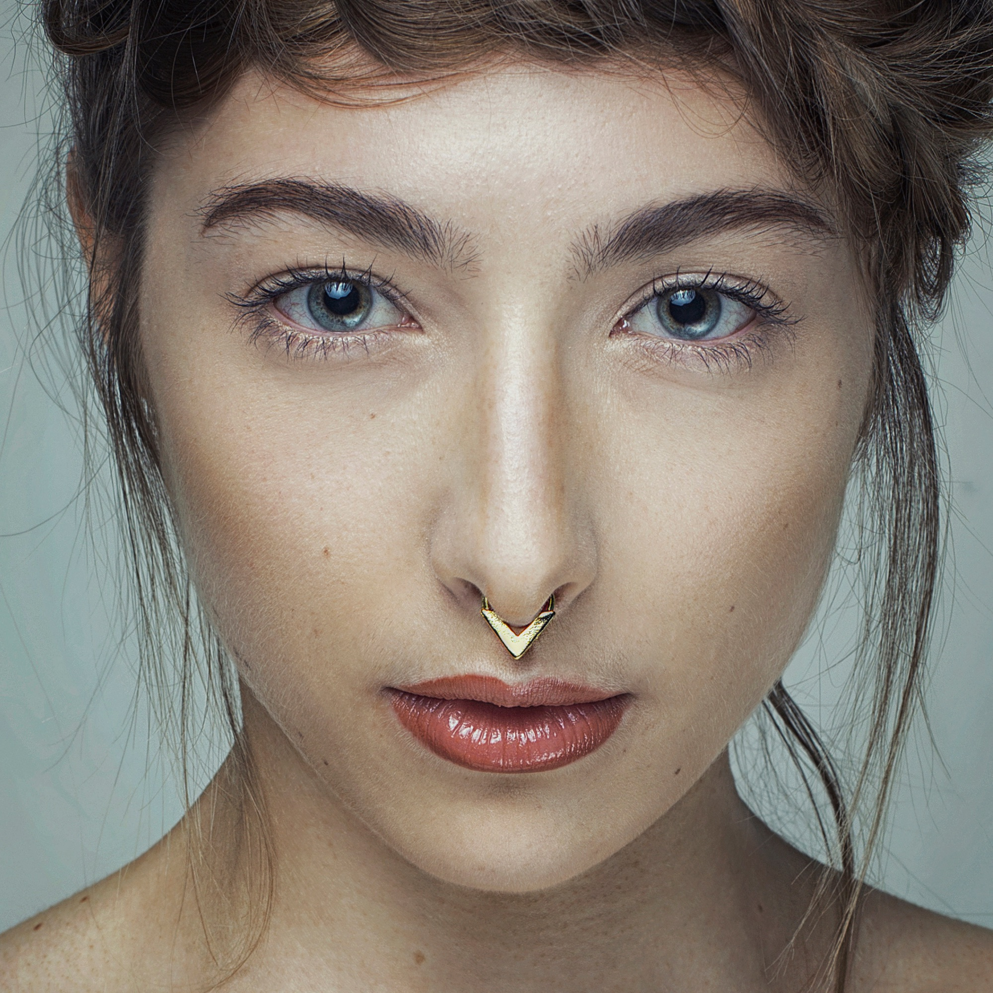 Gold septum jewellery by Elisha Francis