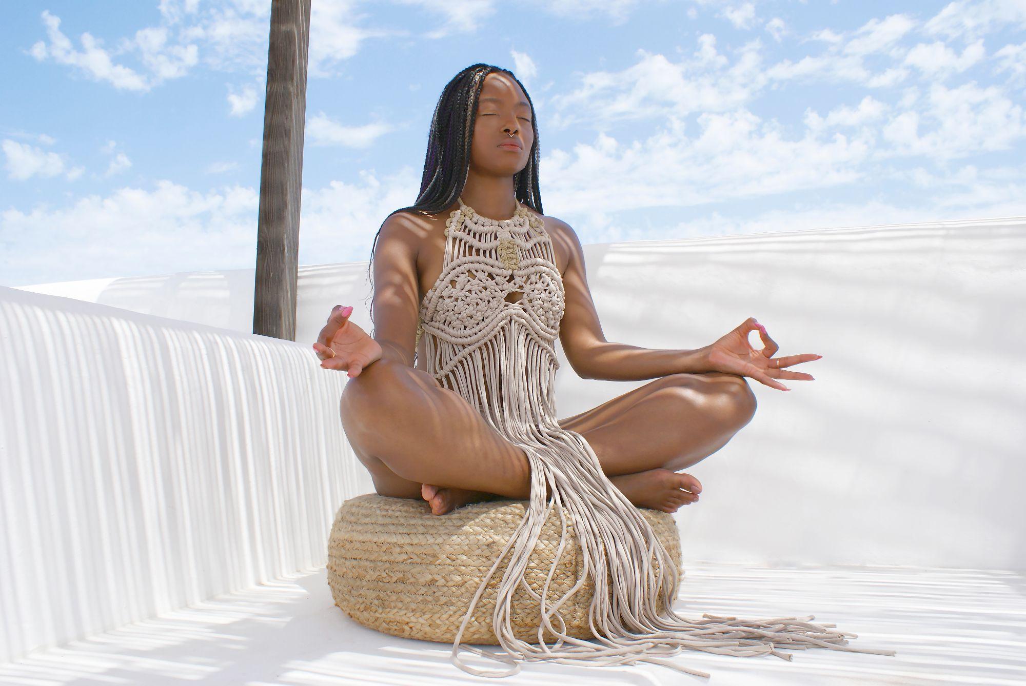 Zakiya Macrae dress yoga pose in Ibiza