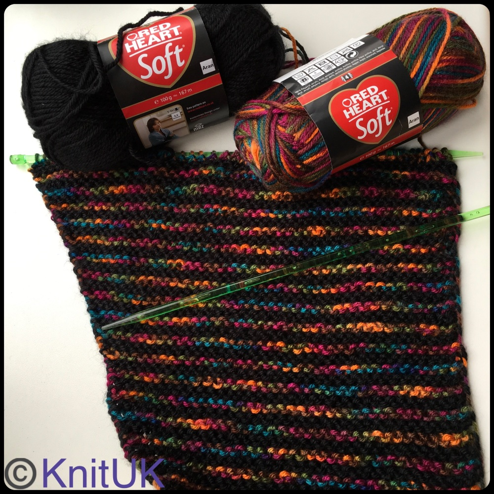 Red heart soft yarn jeweltone colour black scarf on knituk knitting needles