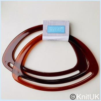 Bag Handles. Trimits - pair of 20cm plastic bag handles: Amber
