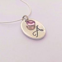 Hand stamped personalised oval initial necklace with swarovski crystal birthstones