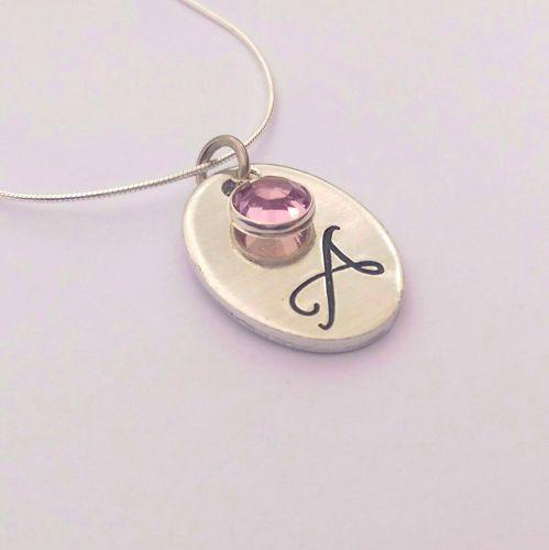 Hand stamped personalised oval initial necklace with swarovski crystal birt