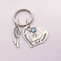 Hand stamped personalised Too beautiful for earth remembrance keyring with pewter wing charm