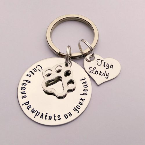 Cats / Dogs leave pawprints on your heart personalised keyring