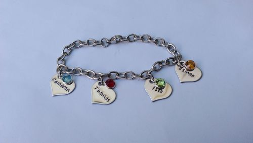 Hand Stamped personalised stainless steel charm bracelet with name and birt
